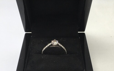 A 18 ct white gold ring inset with 0.45 ct diamond and diamo...