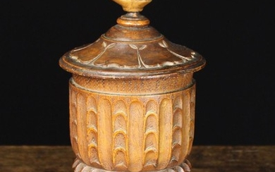 A 19th Century Carved Treen Lidded Tobacco Jar with lead inner liner and lid. The top surmounted by