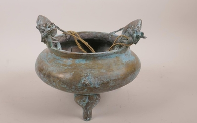 A Chinese bronze censer on tripod supports with two dragon h...