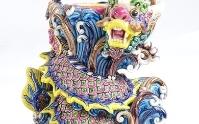 A Chinese glazed ceramic dragon design candle stand, impress...
