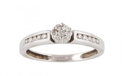 A DIAMOND CLUSTER RING, the brilliant cut diamonds mounted i...