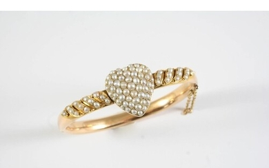 A GOLD AND PEARL SET HEART HALF HINGED BANGLE the heart moti...