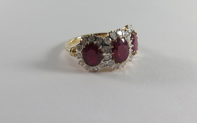 A RUBY AND DIAMOND TRIPLE CLUSTER RING