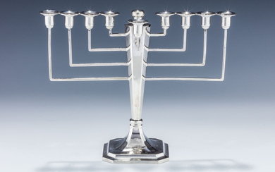 A STERLING SILVER MENORAH. Birmingham, 1935. On a stylized...