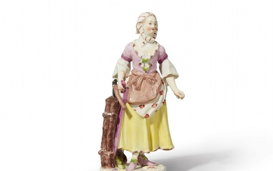 A Vienna porcelain figure of a girl carrying ...
