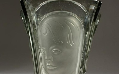 A glass vase, in the style of Lalique - with moulded