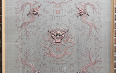 A large Chinese silk embroidered panel depicting a central f...