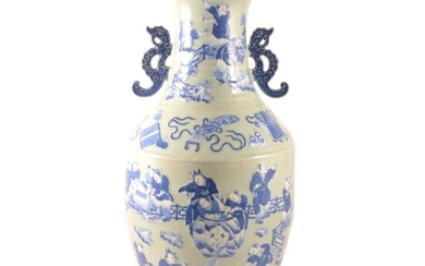 A large floor standing Chinese blue and white vase.