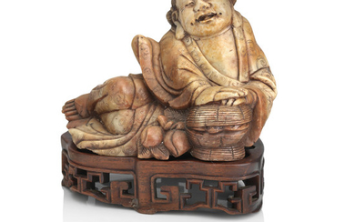 A large soapstone figure of Daoist Immortal on wood stand