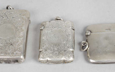 A late Victorian silver vesta case, plus two Edwardian silver examples, two coin holders, etc.