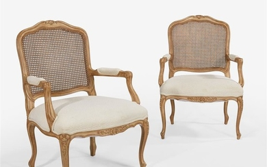 A pair of French Provincial style open arm chairs...