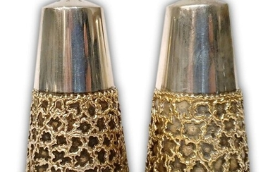 A pair of hallmarked silver salt and pepper pots of tapering...