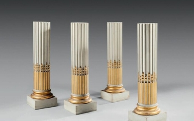 A suite of four moulded, carved and lacquered wood saddles, partially gilded and water-green lacquered, the fluted column with asparagus stem rudentures.