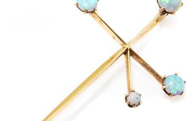 AN ANTIQUE AUSTRALIAN 15CT GOLD OPAL SOUTHERN CROSS BROOCH; set with 5 cabochon crystal opals, hallmarks for Magnus Goldring, length...