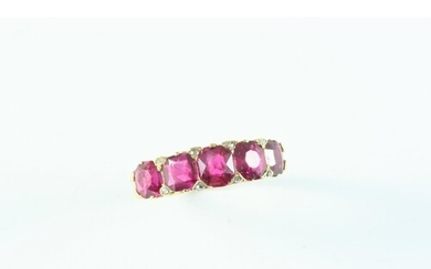 AN ANTIQUE RUBY AND DIAMOND HALF HOOP RING the five graduate...