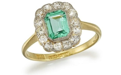 AN EMERALD AND DIAMOND CLUSTER RING The octagonal-cut