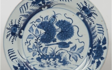 An 18th century Chinese blue and white charger. Painted in u...