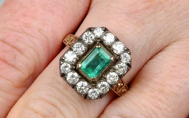 An emerald and brilliant-cut diamond cluster ring.