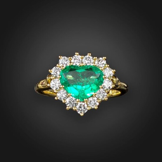 An emerald and diamond heart-shaped cluster ring, the heart-shaped emerald...