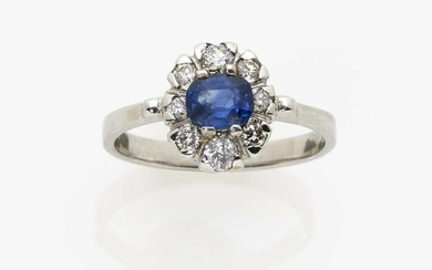 An entourage ring with a ''Kashmir'' sapphire and