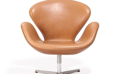 """Arne Jacobsen: """"The Swan"""". Lounge chair upholstered with nougat coloured leather, on lacquered aluminum star base. Manufactured by Fritz Hansen."""