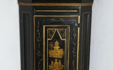 Black and gold lacquered wooden corner cabinet, the front door with far-eastern decor door