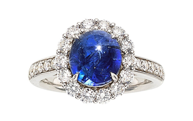 Burma Sapphire, Diamond, White Gold Ring The ring features...