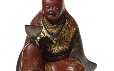 Japan Figurine from the Buddhist pantheon representing a seated kimono figure holding an offering bowl. Meiji period (1868-1912) Height: 26 cm