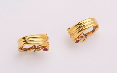 Pair of Art-deco style yellow gold earrings decorated...