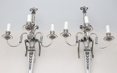 Pair of Louis XVI style wall lamps in silvery bronze, 20th Century.