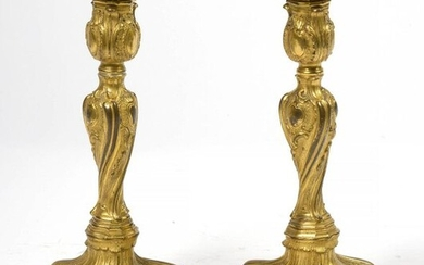 Pair of gilt bronze Regency style torches. Carrying...