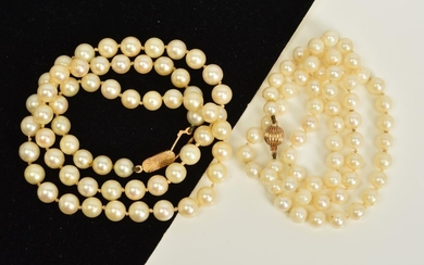 TWO CULTURED PEARL NECKLACES WITH 9CT GOLD CLASPS, both desi...