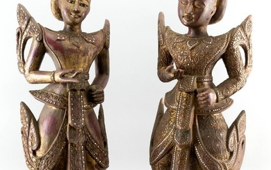 TWO THAI GILT AND LACQUERED CARVED WOOD FIGURES OF DANCERS A male and female, both with mirrored embellishments, standing on wooden...