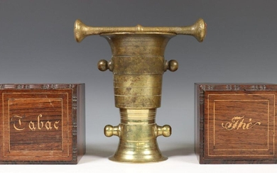 Two mortars with pestle, hereby two wooden boxes;...