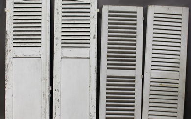 Two pair of early 20th century white painted French louvre shutter doors, comprising an arched pair