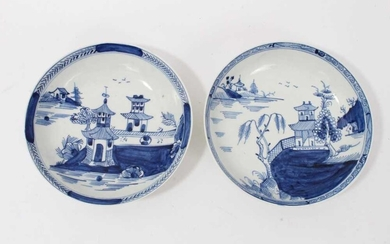 Two similar Lowestoft blue and white saucers, c.1790, painted with Oriental pagoda patterns, ex. Kitty Brumpton collection