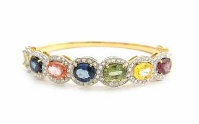 White and yellow gold bangle with diamonds and multicoloured sapphires