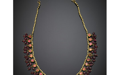 Yellow gold necklace with pink foiled cabochon stones and pendant...