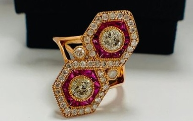 14ct Rose Gold Ruby and Diamond ring featuring...