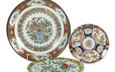 3 wall plates China, 19th/20th century, porcelain, various decorations: 1x cantonal painting with flower bouquet and butterflies, red brush mark; 1x depiction of ornamental fish between pond plants as well as 1x Imari painting, indistinct press mark at...