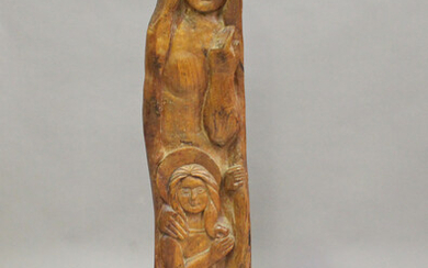 A 20th century carved hardwood figure group, modelled as the Madonna and Child, mounted on a wooden