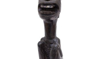 A CARVED WOOD SCULPTURE OF A MALE FIGURE...