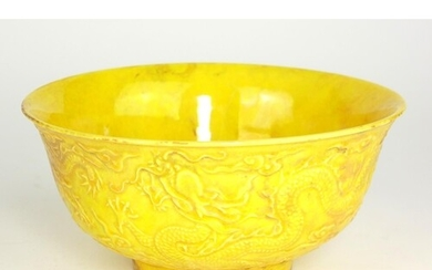 A CHINESE YELLOW GLAZED PORCELAIN BOWL Decorated with dragon...