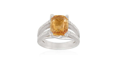 A COLOURED SAPPHIRE AND DIAMOND RING The cushion-shaped...