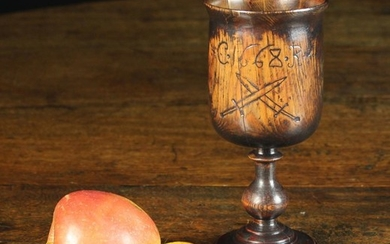 A Charles II Turned Treen Goblet. The bowl incised with initialed C Rx flanking date 1668 above cros
