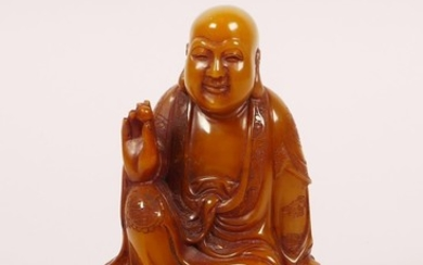 A Chinese soapstone carving of Lohan, on a hardwood stand, w...
