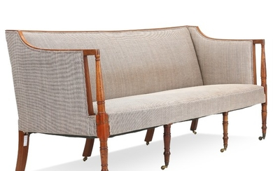 A Danish Empire mahogany settee with brass wheels. English inspired. Ca. 1810. L. 195 cm.
