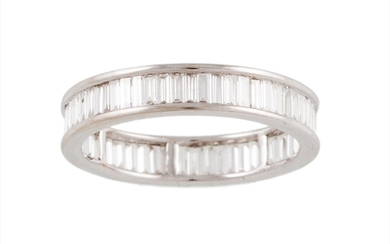 A FULL BANDED DIAMOND ETERNITY RING, set with baguette cut d...
