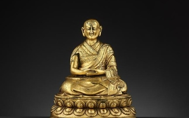 A GILT BRONZE OF THE FIFTH PANCHEN LAMA 17/18TH CT