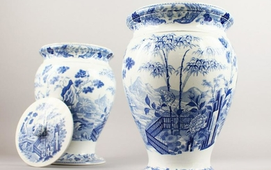 A GOOD PAIR OF WEDGWOOD BLUE AND WHITE VASES WITH LIDS